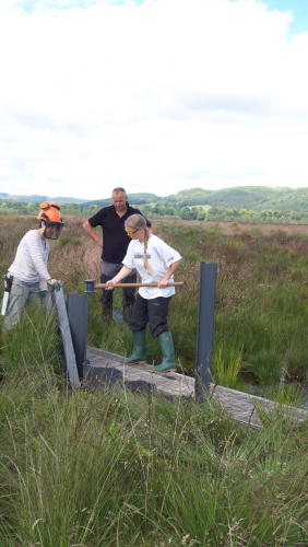 Catriona melling a section of plastic dam with expert instruction from Gordon (credit: Mark Herron)