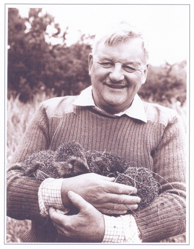 Colin with an armful of Uist hedgehogs. Photo courtesy of Anna McLean
